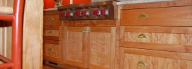 Flame red birch cabinetry